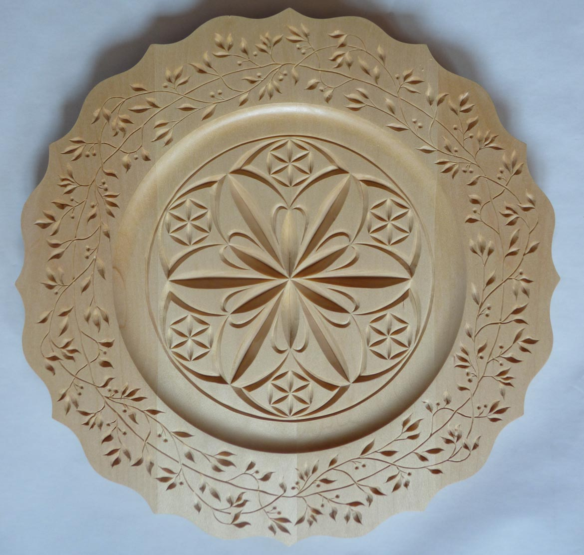 Scalloped rim plate my chip carving