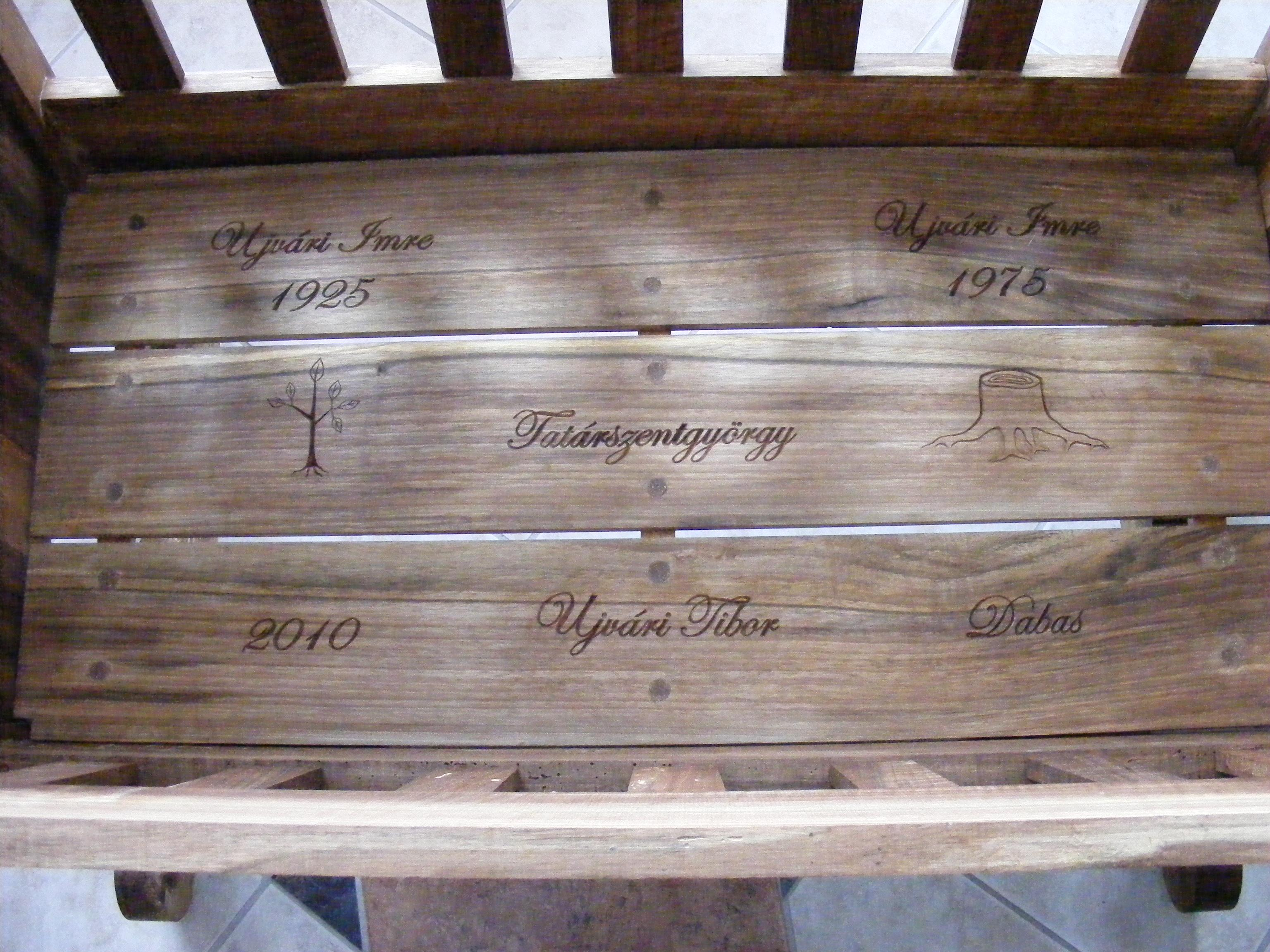 The bottom of the cradle with the names of the grandfather (born in 1925), the customers name in the middle, the girls fathers name (born in 1975) and 2010, the date of birth